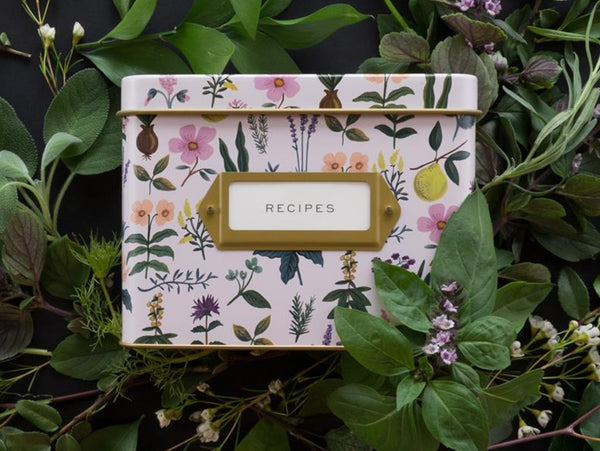 Lilac Rifle Paper Co recipe tea featuring illustrations of herbs and flowers sitting amongst greenery