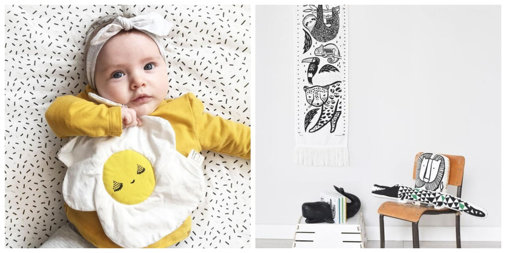 A baby plays with a Wee Gallery egg crinkle toy on the left while a growth chart hangs against a white wall on the right
