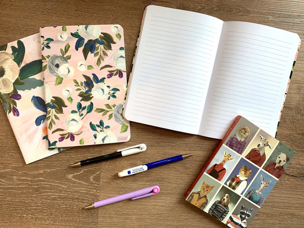 Pretty notebooks and pens for students of all ages!