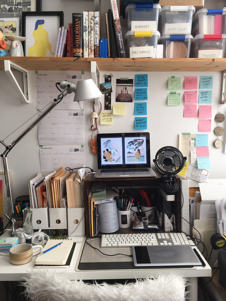 A peak inside Stephanie Cheng's creative space where post-its line the walls, trinkets and books fill the shelf above her desk, and creativity flows