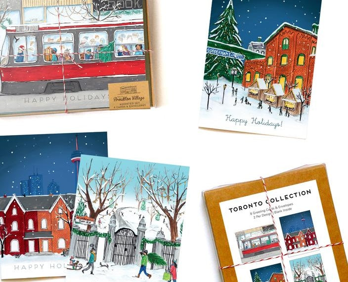 Flat lay of Made in Brockton Village's recycled paper Toronto-themed Christmas cards, available in boxed sets and singles