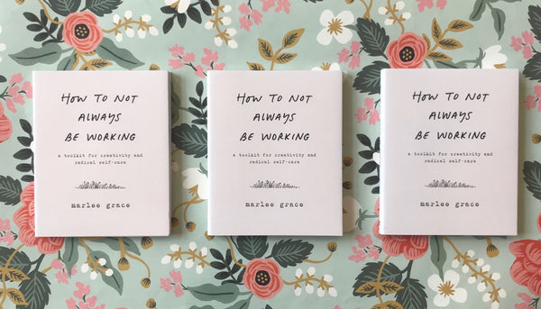 Three copies of How Not to Always Be Working laying across a green and pink floral background