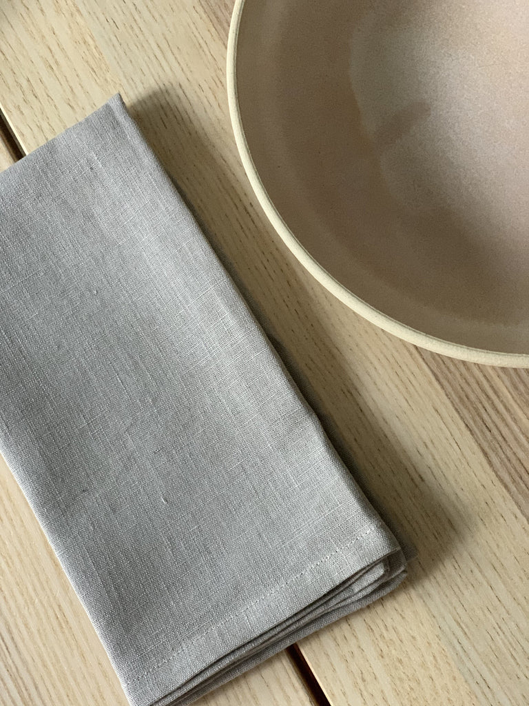 "A grey Linen Napkin by Miranda Bennett Studio, measuring 16"" x 16"""