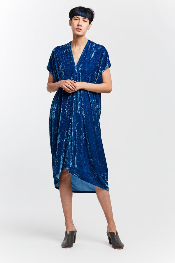 Indigo Velvet Dress. Model wears the ethically dyed blue dress.