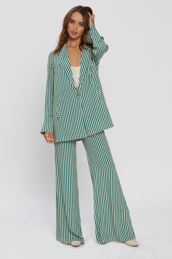 Model in green and white stripe blazer