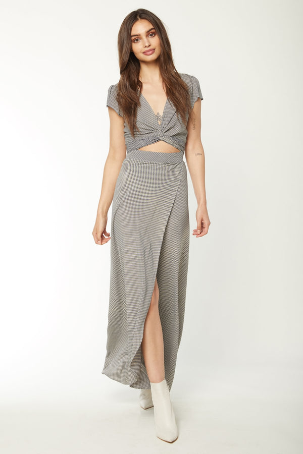 Model in grey floor length maxi dress with wrap top and leg slit