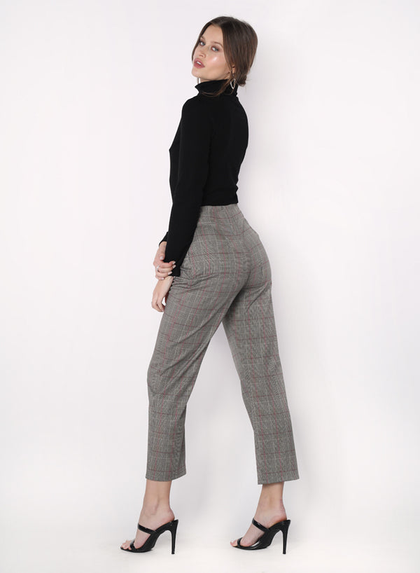 Model wearing grey plaid cropped pants