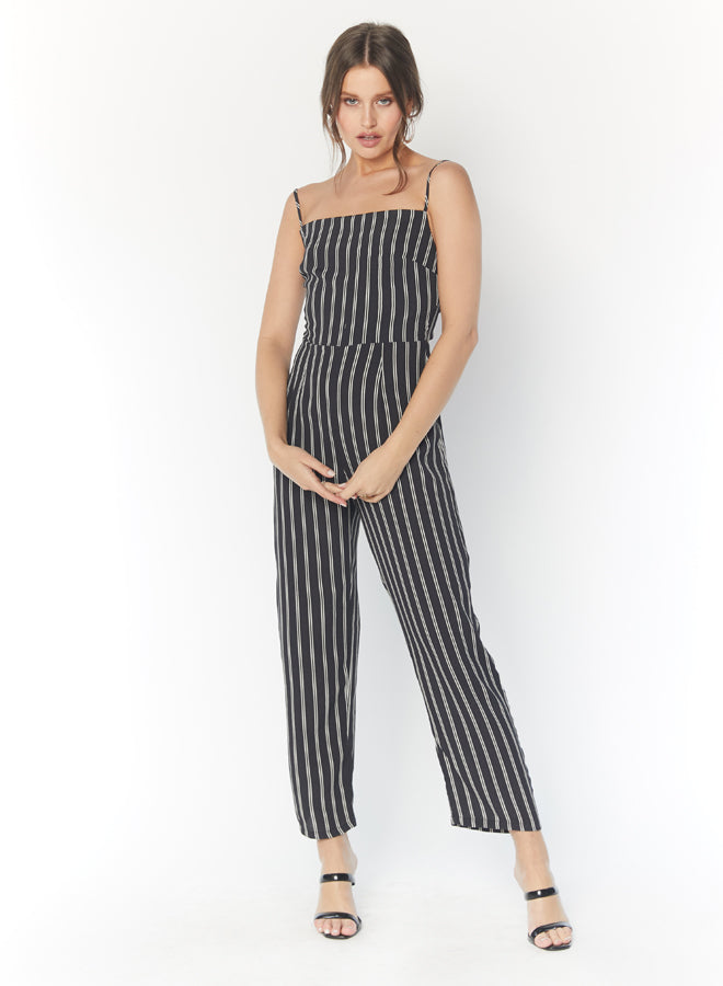 Model wearing blue striped jumpsuit with thin straps