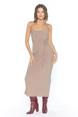 Model wearing tan midi dress with thin straps