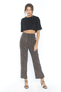 Model wearing brown printed pants