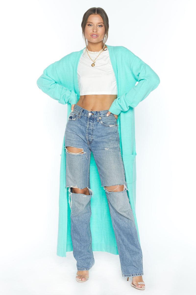 Model wearing neon mint long sleeve knit duster