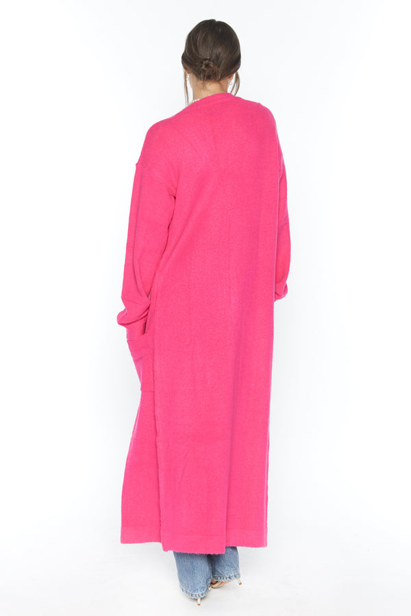 Model wearing neon pink long sleeve knit duster