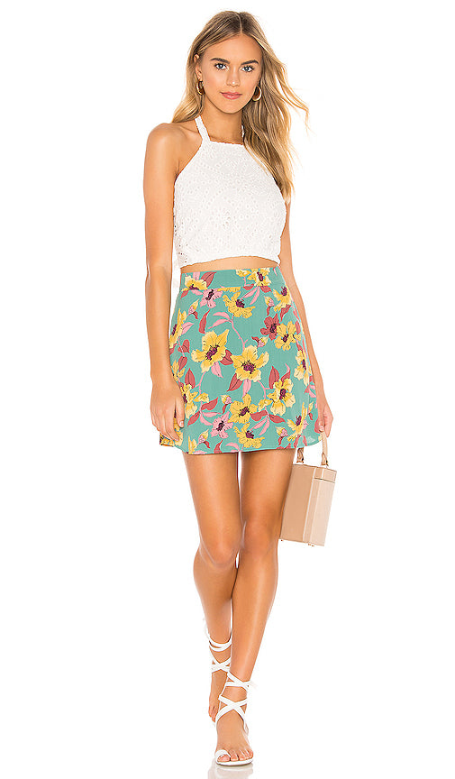 Model wearing green floral print mini skirt