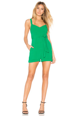 Model wearing green short romper