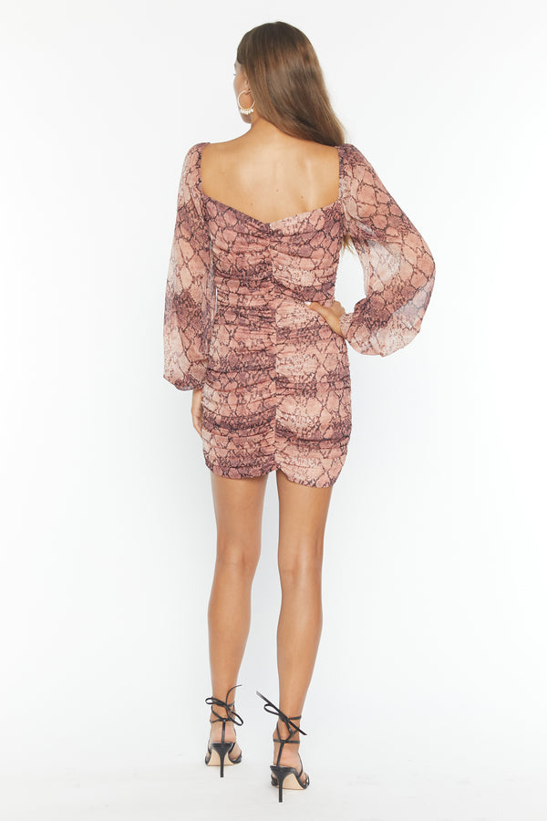 Model wearing snakeskin chiffon long sleeve mini dress