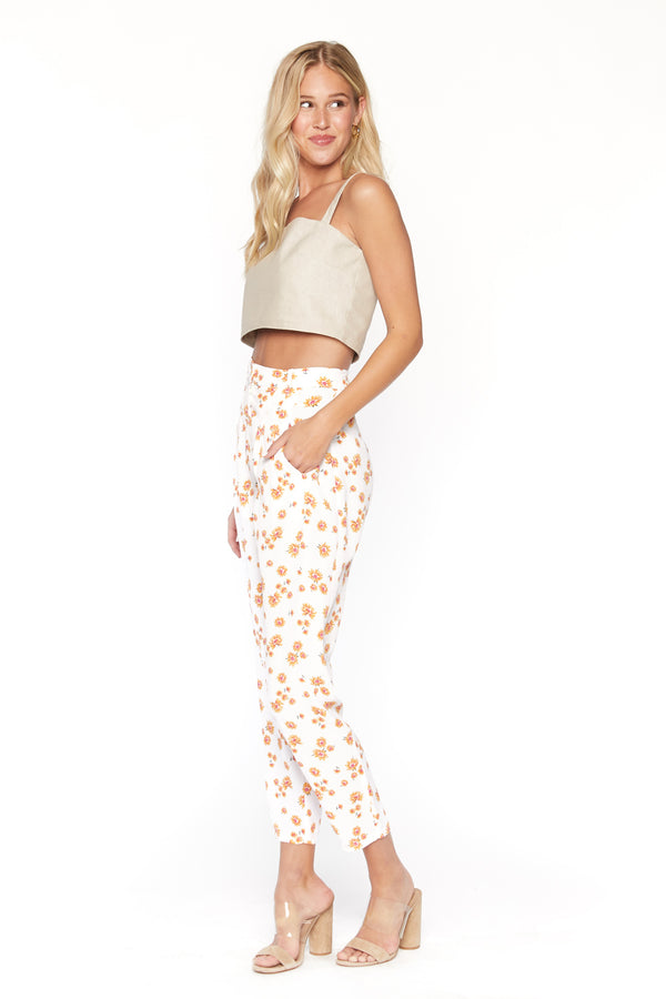 Model wearing white floral print cropped pants