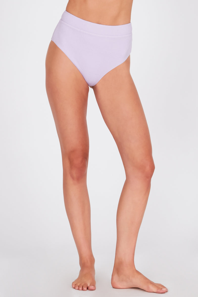 Model in high waisted lilac swim suit bottoms