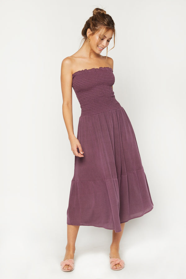Model wearing purple sleeveless dress