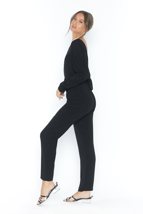 Model wearing black long sleeve jumpsuit