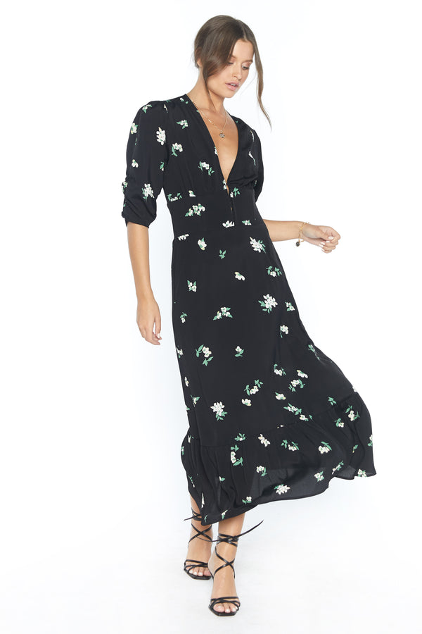 Model wearing black floral print maxi dress with v-neck