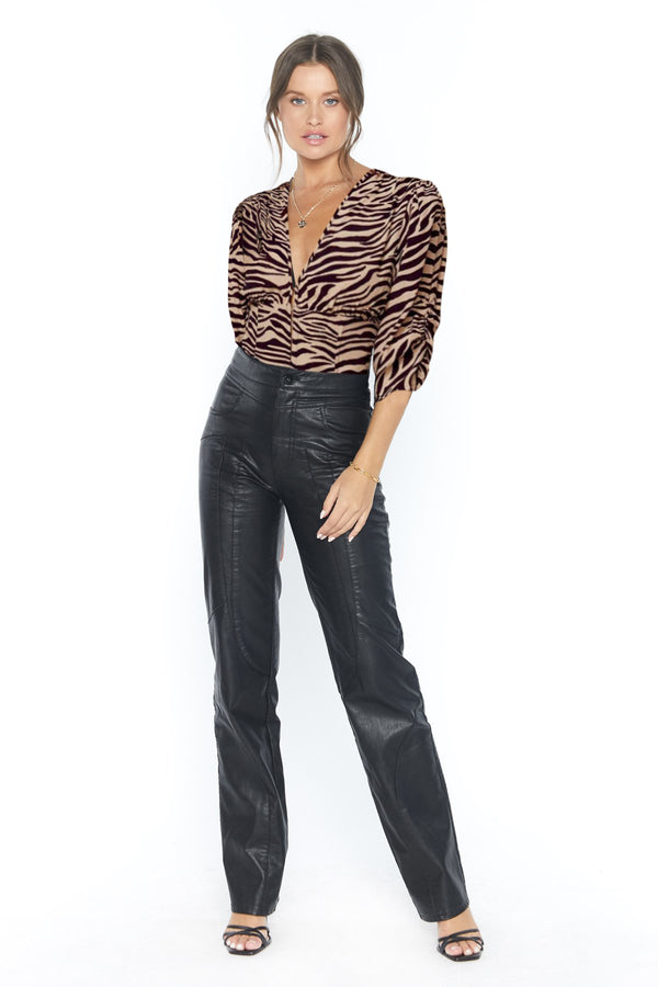 Model wearing tiger print v-neck shirt with 3/4 sleeves