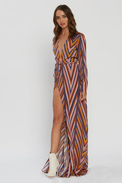 Model wearing rainbow stripe maxi dress with v-neck