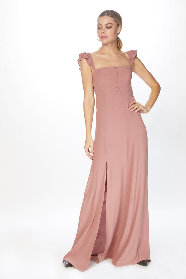 Model in pink maxi dress with ruffle straps
