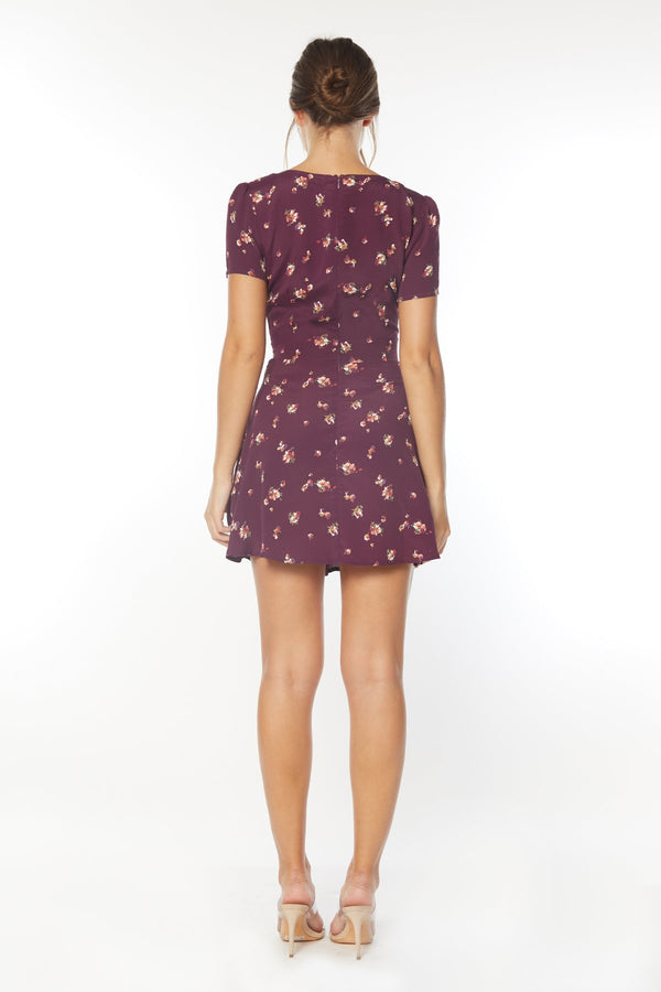 Model wearing purple floral print mini dress