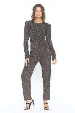 Model wearing brown long sleeve printed jumpsuit