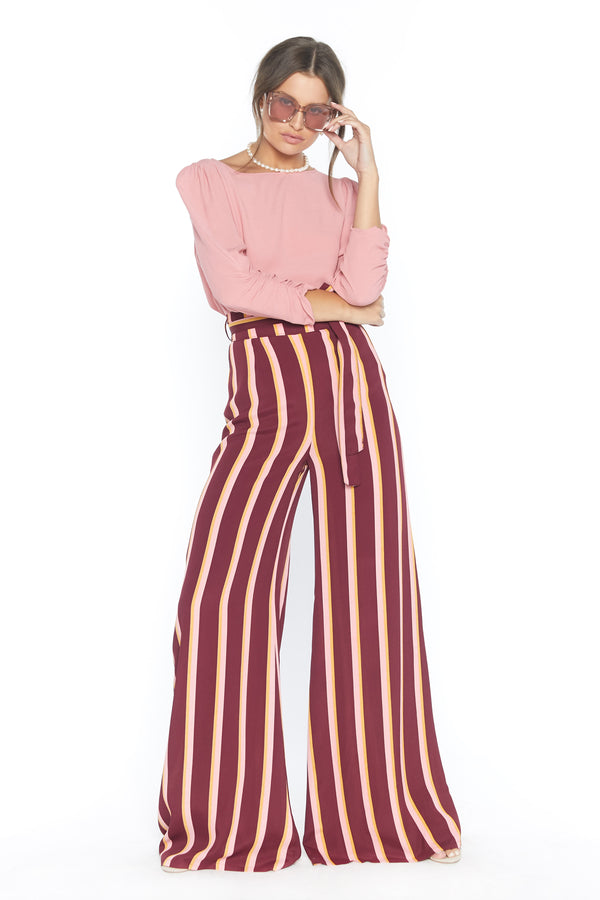 Model wearing pink stripe wide leg pants with fabric belt