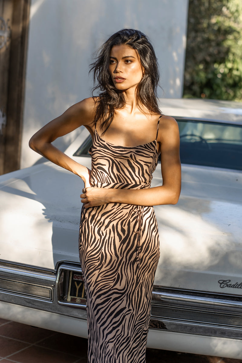 Model wearing tiger print midi dress with thin straps