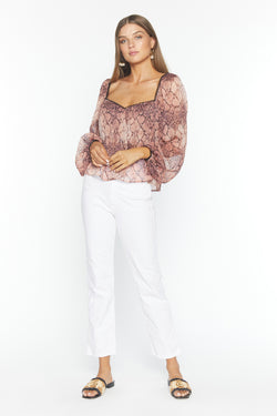 Model wearing snakeskin chiffon long sleeve blouse