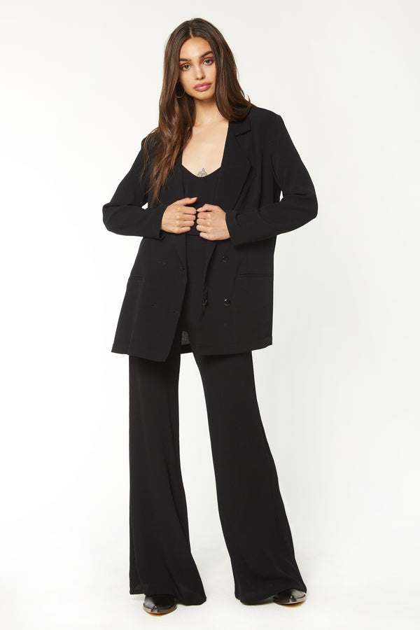 Model wearing black blazer