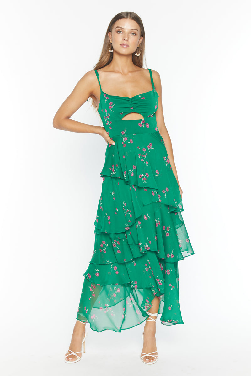 Model wearing green floral print chiffon dress with tie straps