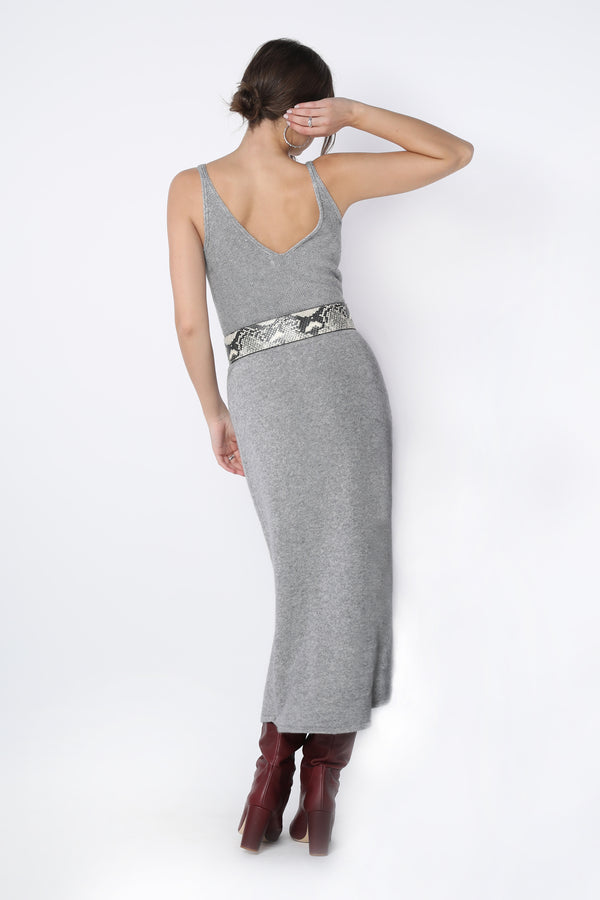 Model wearing long form fitting grey knit skirt