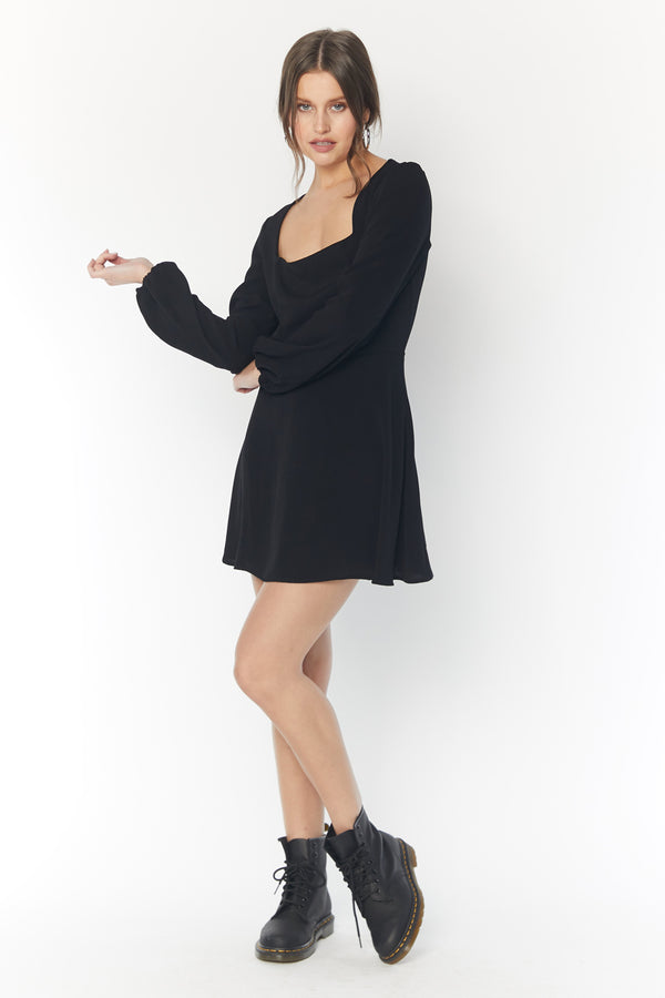 Model wearing black long sleeve mini dress