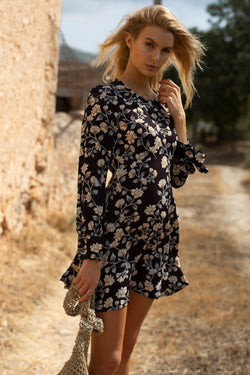 Model wearing blue long sleeve floral print mini dress
