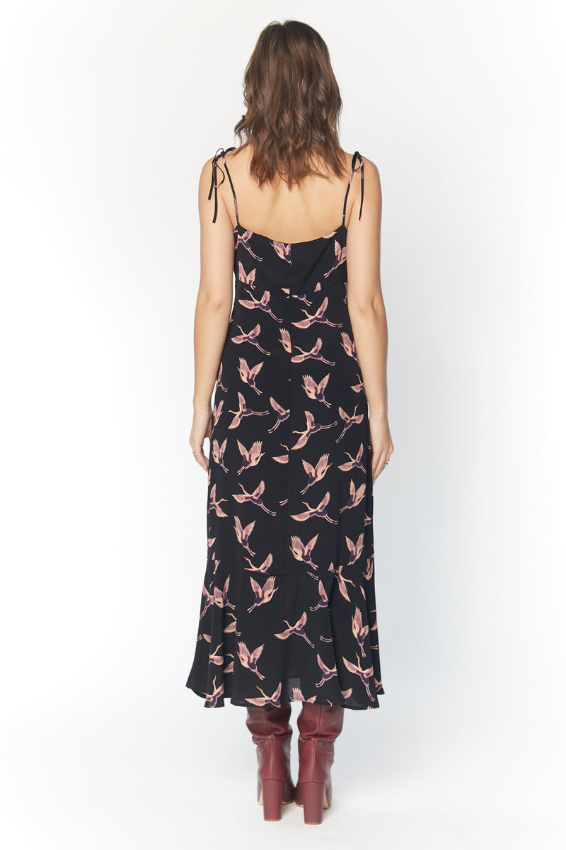 Model wearing bird printed midi dress with thin straps