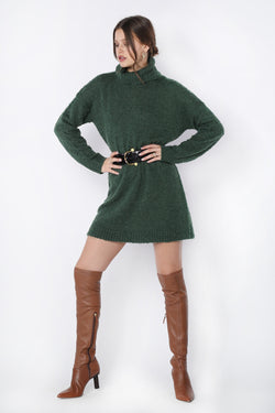 Model wearing a green turtleneck knit dress