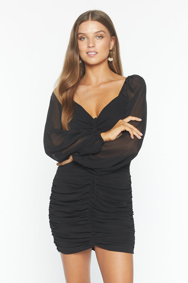 Model wearing black chiffon long sleeve mini dress
