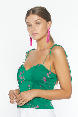 Model wearing green floral print tank top with thin straps