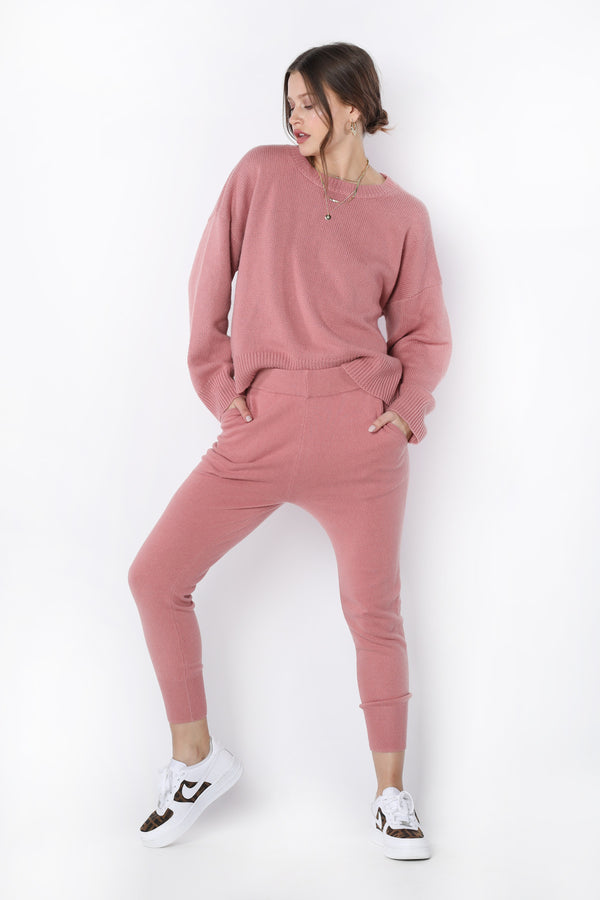 Model wearing pink long sleeve sweater