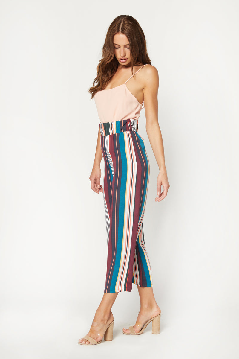 Model wearing striped wide leg pants