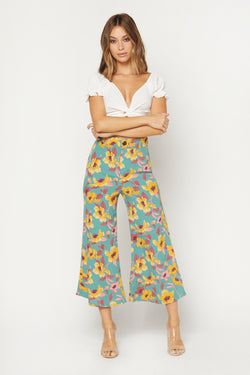 Model wearing green floral wide leg pants