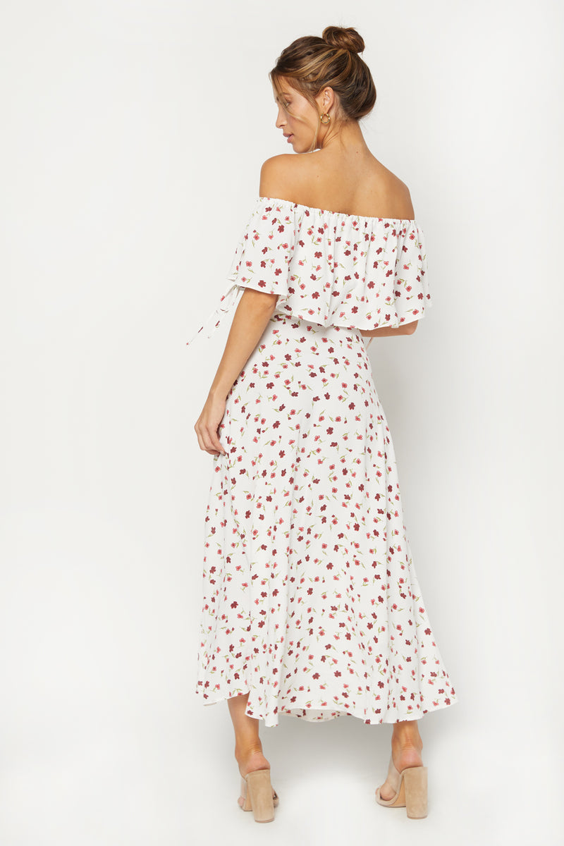 Model wearing white floral print off the shoulder top