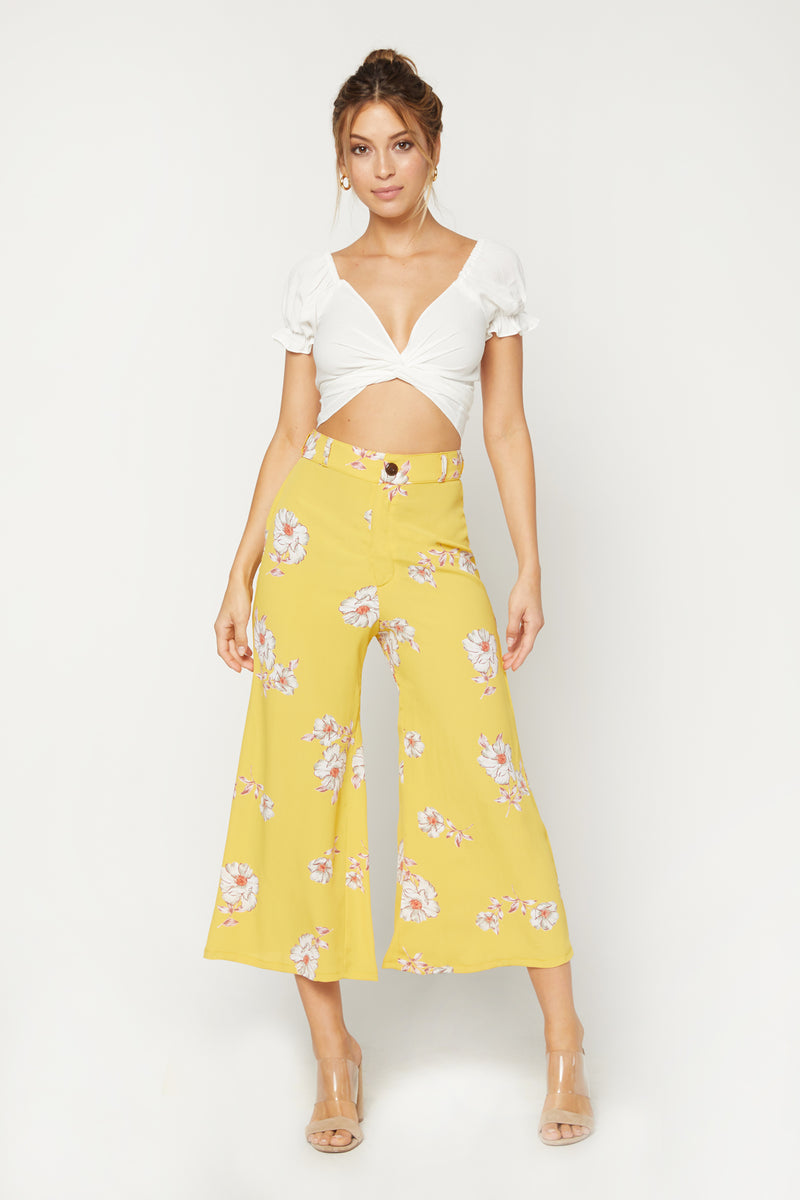 Model wearing yellow floral wide leg pants