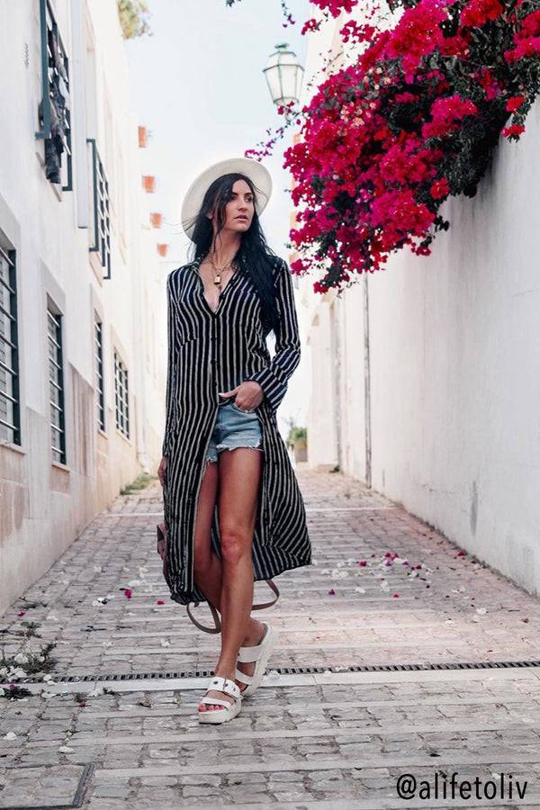Model wearing blue striped long sleeve dress