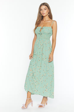 Model wearing mint floral print maxi dress