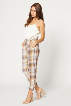 Model wearing brown plaid cropped pants