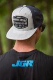 JGRMX Emblem Flatbill Snapback Hat on Kyle Peters